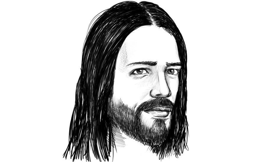 Mann mit Mittelscheitel und langen Haaren